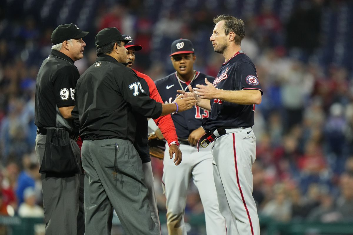 Nationals pitcher Max Scherzer is checked for foreign substances during Tuesday's l game against the Phillies.