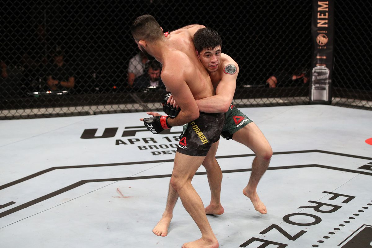 Brandon Moreno of Mexico attempts to take down Jussier Formiga of Brazil in their flyweight fight during the UFC Fight Night event on March 14, 2020 in Brasilia, Brazil.