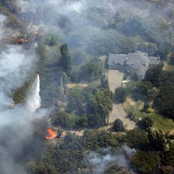 A chopper drops water on a wildfire at the mouth of Weber Canyon on Tuesday, Sept. 5, 2017.