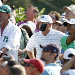 Tiger Woods watches his tee shot from the 15th hole during a practice round for the Masters golf tournament Wednesday, April 4, 2012, in Augusta, Ga.