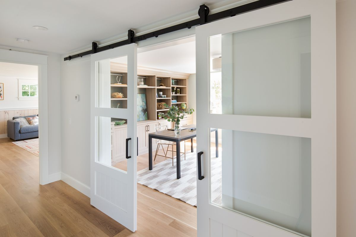 A work from home office behind sliding barn doors.