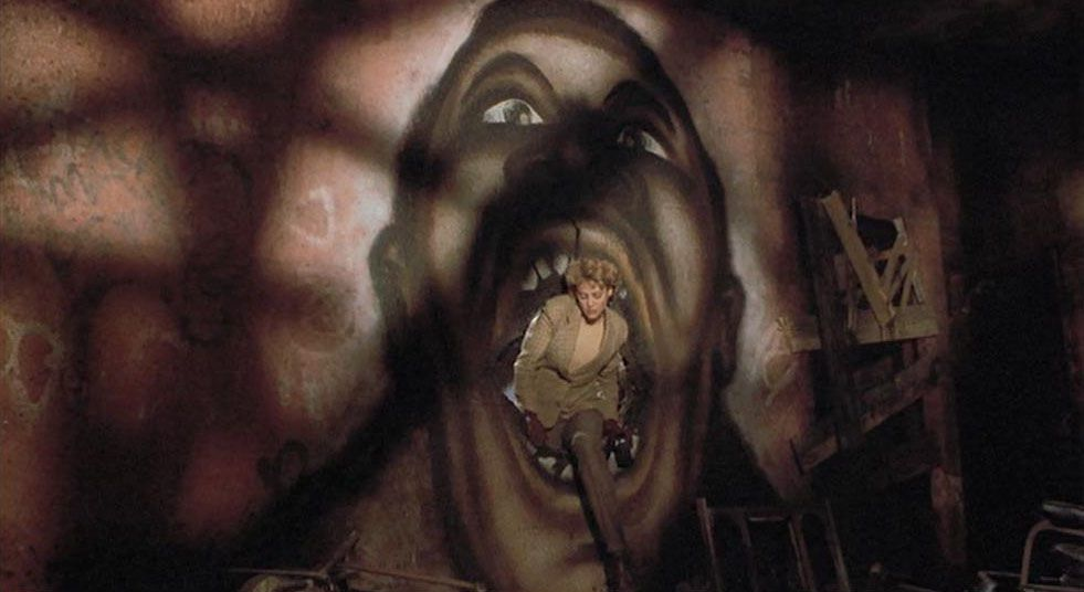 Helen Lyle (Virginia Madsen) crawls through the mouth of a mural of Candyman in 1992's Candyman directed by Bernard Rose