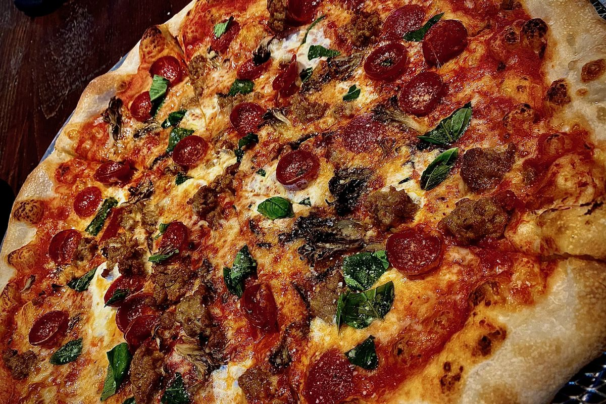 A deck-oven pizza topped with sausage, 'roni cups and hen of the woods mushroom at Ballston Local
