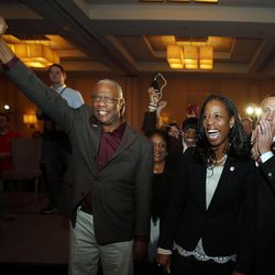 Mia Love, 4th Congressional District Republican candidate, celebrates as she declares victory on election night in Salt Lake City, Tuesday, Nov. 4, 2014. At left is her father, Maxime Bourdeau, mother Marie Bourdeau, and at right is her husband, Jason.