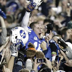 BYU quarterback Max Hall celebrates the victory over the Utes at LaVell Edwards Stadium in Provo Saturday. BYU won in overtime 26-23.