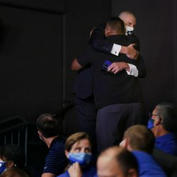 BYU basketball coach Mark Pope hugs BYU football coach Kalani Sitake at a press conference announcing that BYU has accepted an invitation to the Big 12 Conference at BYU in Provo on Friday, Sept. 10, 2021. BYU will play all sports provided by the Big 12 except for equestrian, rowing and wrestling. Men's volleyball will continue to play in the Mountain Pacific Sports Federation, as the Big 12 does not offer the sport.