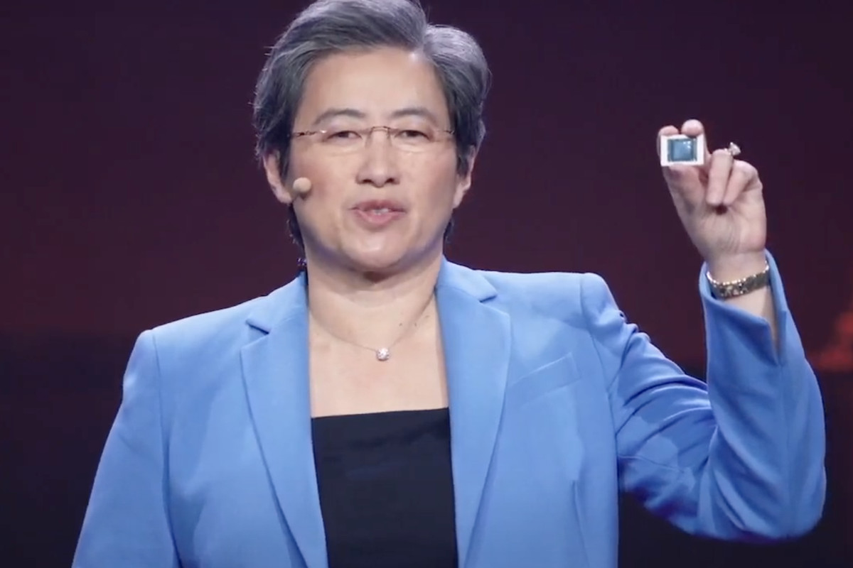 AMD CEO Lisa Su holds up a Ryzen 5000 mobile chip at CES 2021.