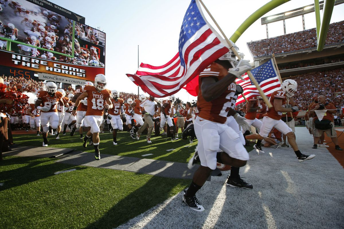 AUSTIN, TX - SEPTEMBER 10:  Players of the Texas Longhorns take the field for their game against the BYU Cougars on September 10, 2011 at Darrell K. Royal-Texas Memorial Stadium in Austin, Texas.  (Photo by Erich Schlegel/Getty Images)