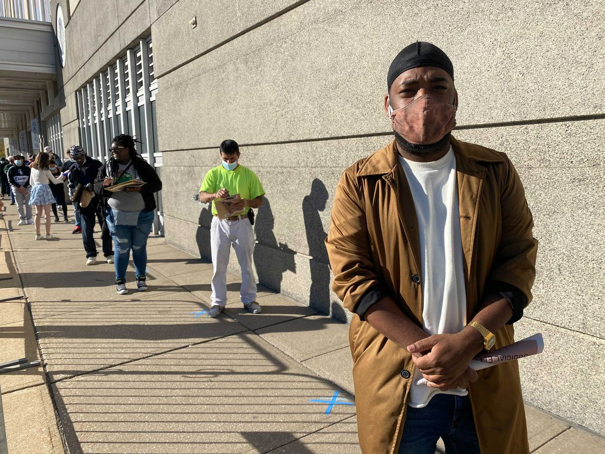 Fahem Adam, 30, waiting in line to vote at the United Center.