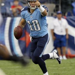 Tennessee Titans quarterback Jake Locker directs a receiver as he rolls out against the New Orleans Saints in the first quarter of an NFL football preseason game on Thursday, Aug. 30, 2012, in Nashville, Tenn.