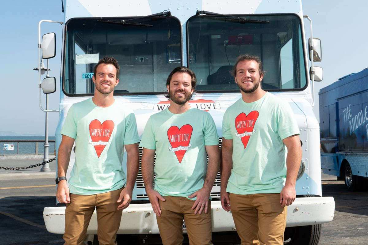 """Brothers Steve, Adam and Jared Terry of Utah's Waffle Love pose for a photo on location at """"The Great Food Truck Race: All Stars."""""""