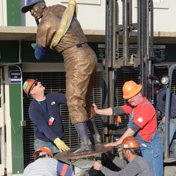 5:20 p.m. Bolts being fitted into the statue base -