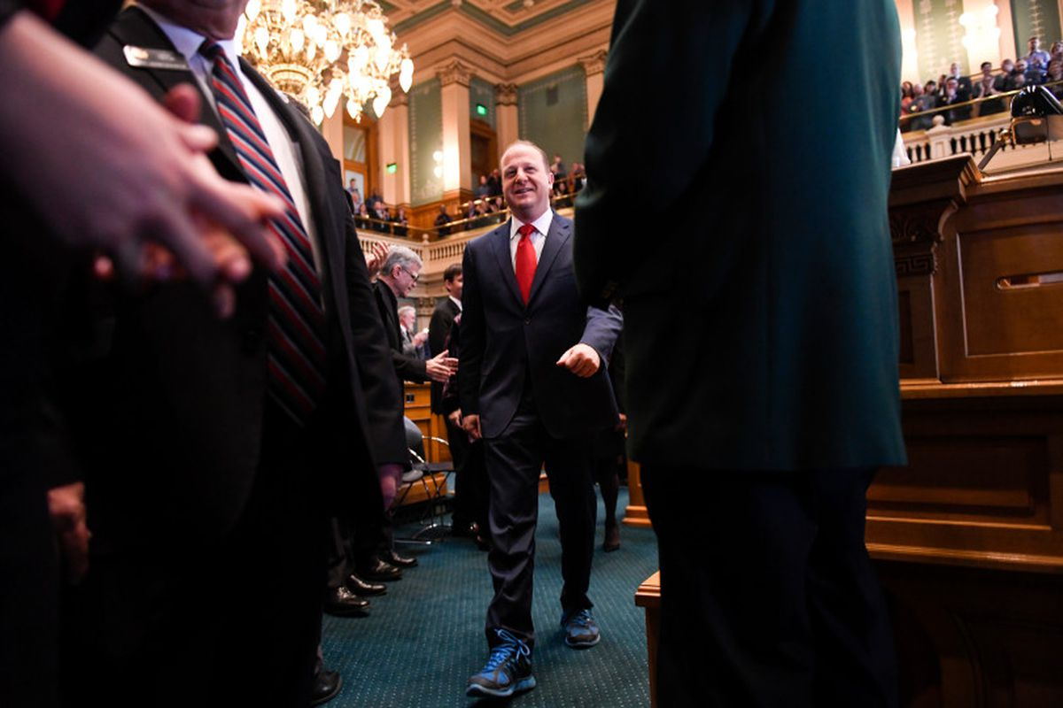 Jared Polis is introduced on the House floor before delivering his first State of the State address.