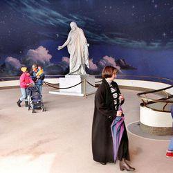 Vistors are led down the ramp of the North Visitors' Center by sister missionary after listen to taped program.