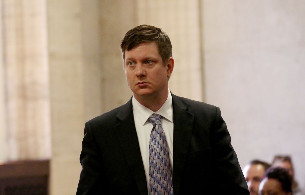 Chicago Police Officer Jason Van Dyke approaches the bench during a hearing in May at the Leighton Criminal Court Building in Chicago.   Nancy Stone/Chicago Tribune/Pool photo