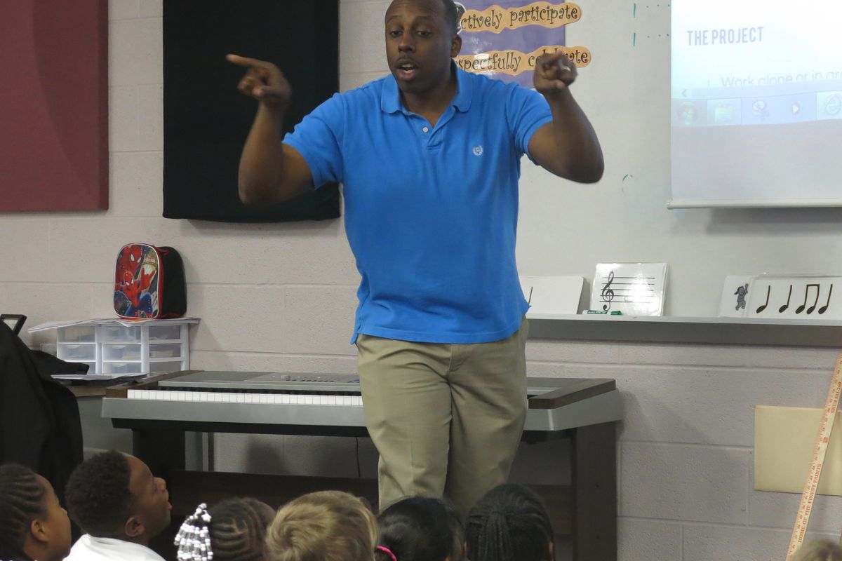 Christopher Blackmon leads second-grade students in a song he wrote and composed as a music teacher at Thomas Edison Elementary School in Nashville.