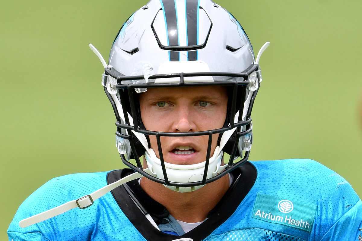 Christian McCaffrey #22 of the Carolina Panthers looks on during a drill during a training camp session at Bank of America Stadium on August 24, 2020 in Charlotte, North Carolina.