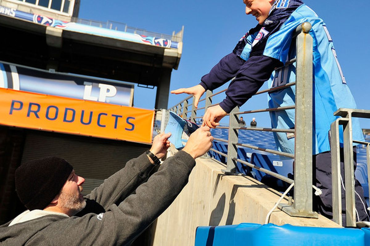 NASHVILLE TN - DECEMBER 19:  Kerry Collins #5 of the Tennessee Titans signs an autograph for a fan before a game against the Houston Texans at LP Field on December 19 2010 in Nashville Tennessee.  (Photo by Grant Halverson/Getty Images)
