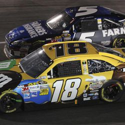 Kyle Busch (18) passes Kasey Kahne (5) in Turn 4 during the NASCAR Sprint Cup Series auto race at Richmond International Raceway in Richmond, Va., Saturday, April 28, 2012.