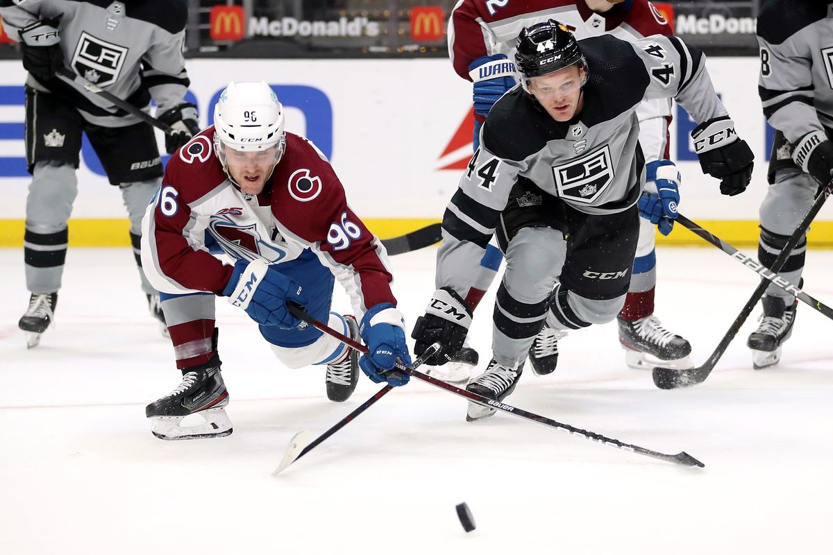 MAY 08: Mikko Rantanen #96 of the Colorado Avalanche and Mikey Anderson #44 of the Los Angeles Kings battle for control of the puck during the first period at Staples Center on May 08, 2021 in Los Angeles, California.