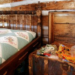 An old bed and trunk were donated to the Daughters of the Utah Pioneers' recently refurbished historic cabin in Santaquin.