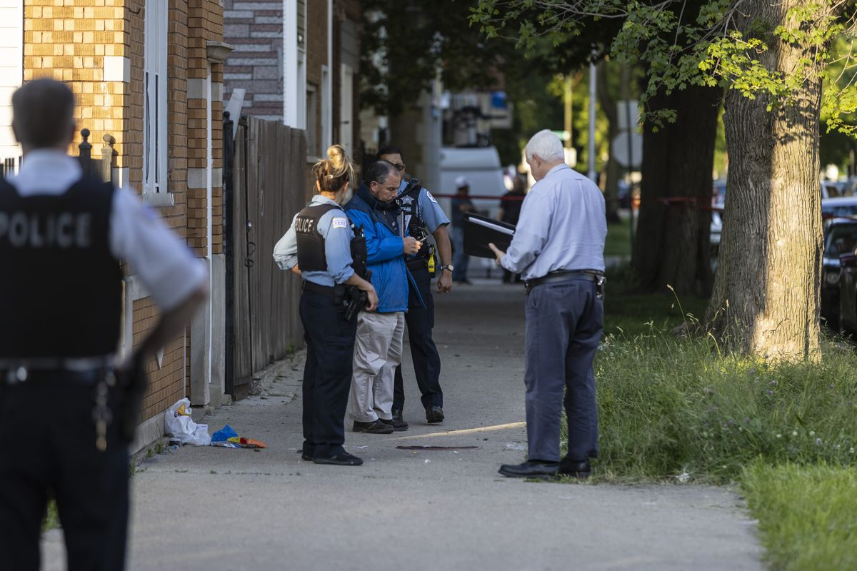 Police investigate the scene were a 14-year-old girl was shot and critically wounded on the 1700 block of West 48th Street in Back of Yards, Wednesday, June 2, 2021. | Anthony Vazquez/Sun-Times