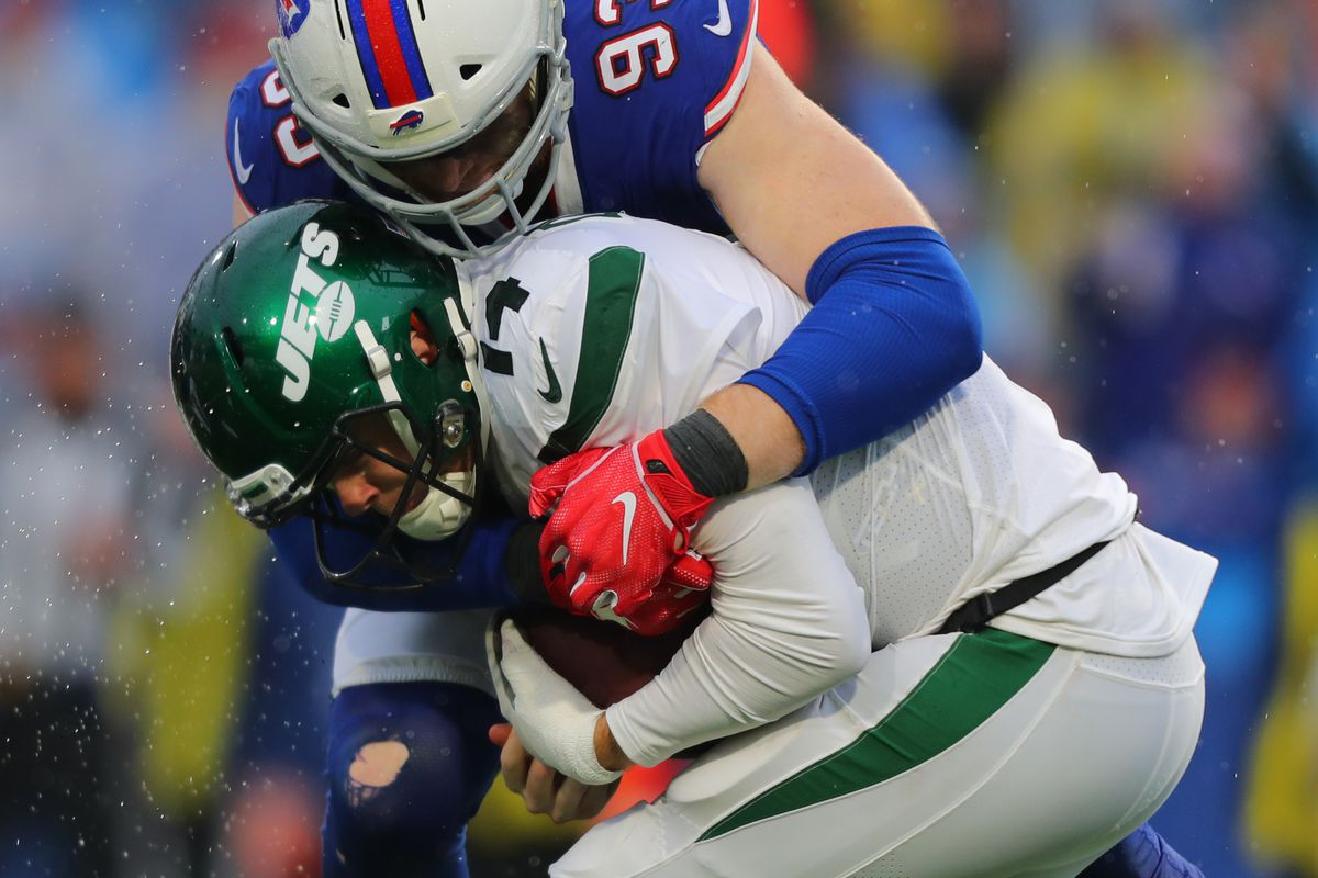 Trent Murphy of the Buffalo Bills sacks Sam Darnold of the New York Jets during the second half at New Era Field on December 29, 2019 in Orchard Park, New York.
