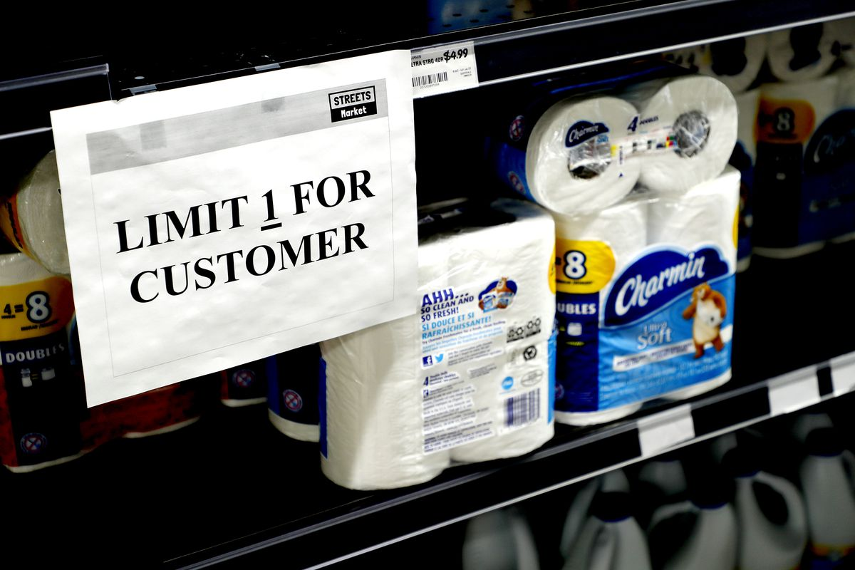 """A sign on a shelf of toilet paper in a store reads, """"Limit 1 for customer."""""""