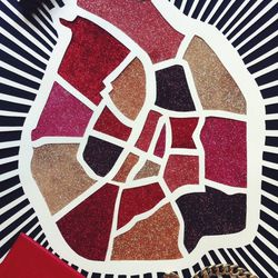 My ode to Paris. The art is an intricately cutout map of the city by Diane. It inspires me to take a break from the red lips and go with <b>Chanel's</b> Venise instead, which is kind of a dark rosy brown.