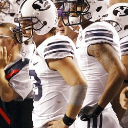Riley Nelson of the Brigham Young Cougars watches from the sidelines during NCAA football in Boise, Thursday, Sept. 20, 2012.