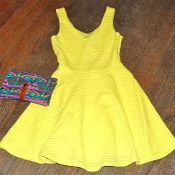 <b>Sugarlips</b> Yellow Textured Fit-and-Flare Dress, $68; <b>Street Level</b> Multicolor Tribal Clutch, $54