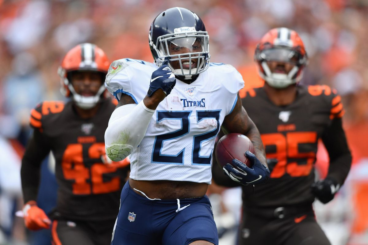 Derrick Henry #22 of the Tennessee Titans outruns Morgan Burnett #42 of the Cleveland Browns and Myles Garrett #95 of the Cleveland Browns for a 75-yard touchdown reception in the third quarter at FirstEnergy Stadium on September 08, 2019 in Cleveland, Ohio .