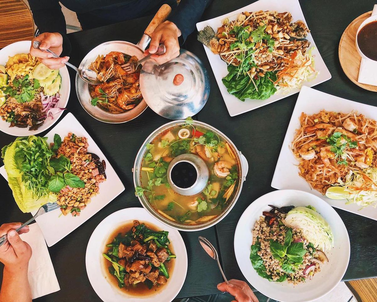 An overhead display of Thai dishes.