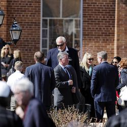 People greet one another following the memorial service for Deedee Corradini at Wasatch Presbyterian Church in Salt Lake City, Monday, March 9, 2015.