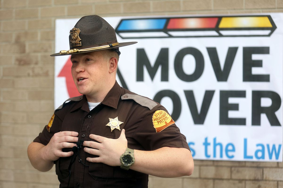Utah Highway Patrol trooper Thomas Burnam talks about the importance of moving over to give space to emergency responders working on the side of the road during a press conference at the UHP headquarters in Taylorsville on Tuesday. Burnam says he has been hit two times.