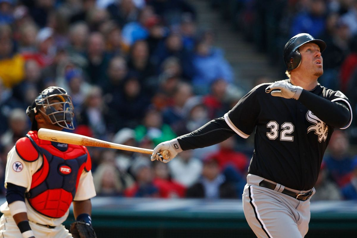 CLEVELAND - APRIL 01:  Adam Dunn #32 of the Chicago White Sox hits a two-run home run agains the Cleveland Indians during the Opening Day game on April 1, 2011 at Progressive Field in Cleveland, Ohio.  (Photo by Jared Wickerham/Getty Images)