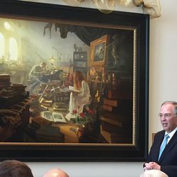 """Elder Neil L. Andersen of the Quorum of the Twelve Apostles complimented artist Greg Olsen on his new painting, """"Treasures of Knowledge,"""" which was commissioned by Leo and Annette Beus and donated to BYU."""