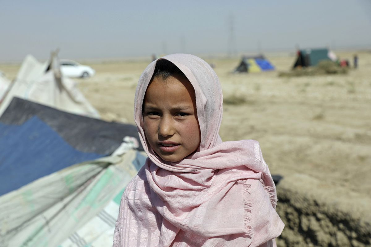 Sakina, an internally displaced Afghan girl who fled her home due to fighting between the Taliban and Afghan security personnel, speaks to The Associated press at a camp on the outskirts of Mazar-e-Sharif, northern Afghanistan, Thursday, July 8, 2021.