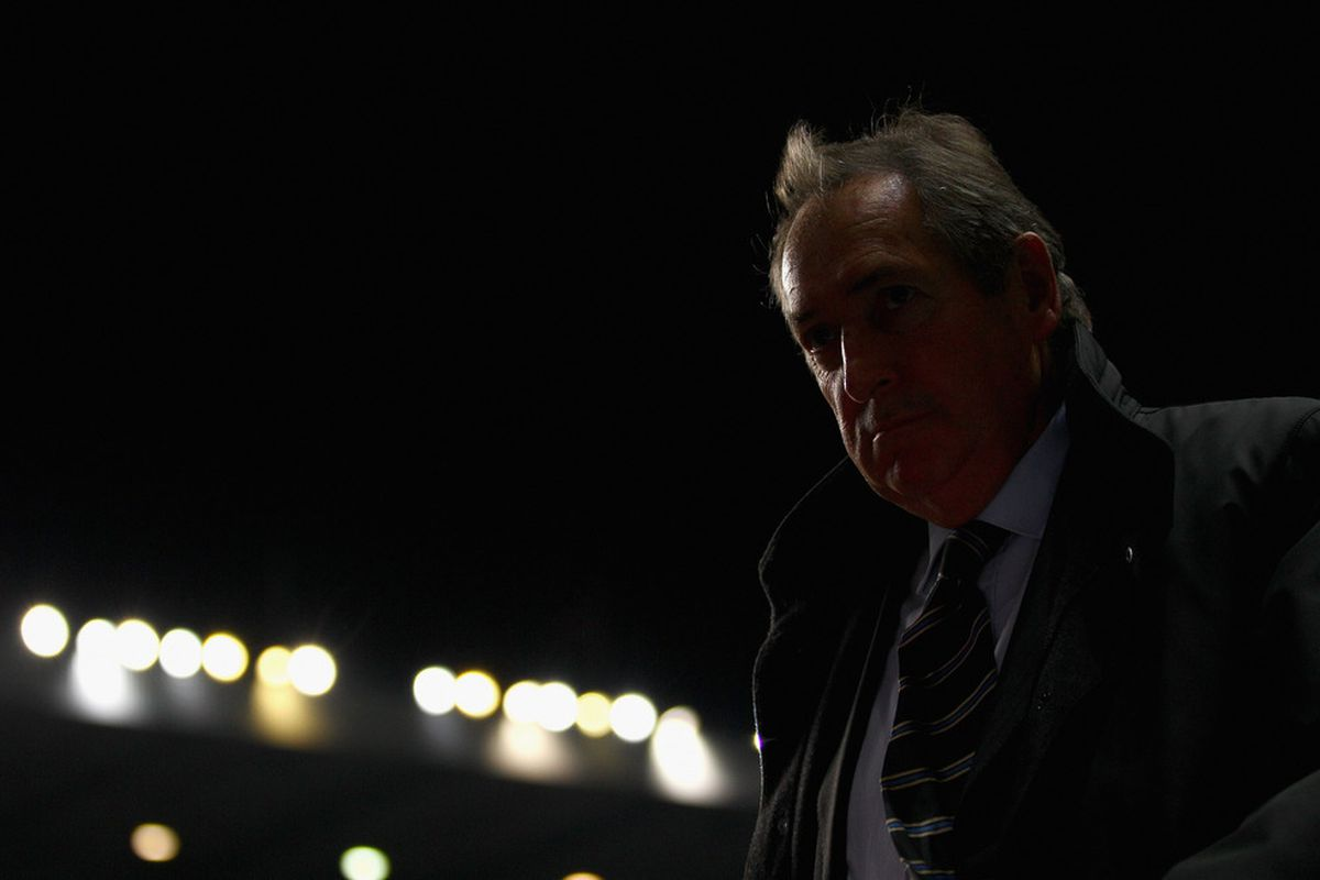 It's a good thing Gerard Houllier's head is enormous, because he's gonna' need a whole lotta' brain to get us through the next few months. (Photo by Richard Heathcote/Getty Images)