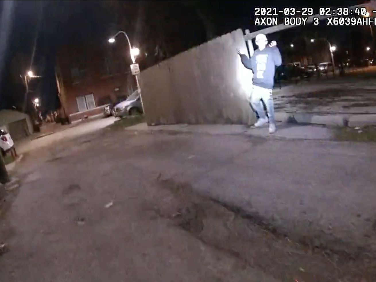 A still frame from video recorded by a Chicago police officer's body-worn camera shows Adam Toledo just before he was shot by the officer.