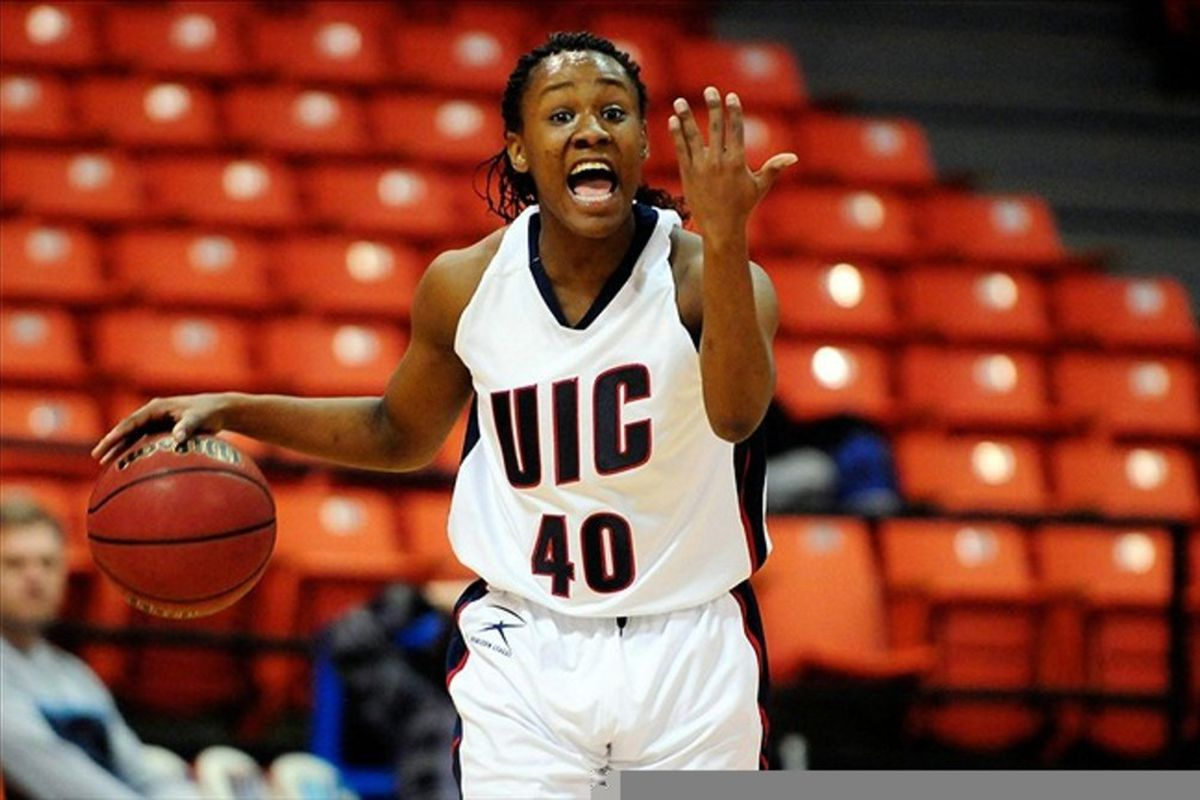 March 3, 2012; Chicago, IL, USA; UIC Flames guard Shamiea Green (40) brings the ball up court during the first half against the Green Bay Phoenix at the UIC Pavilion. Mandatory Credit: Reid Compton-US PRESSWIRE
