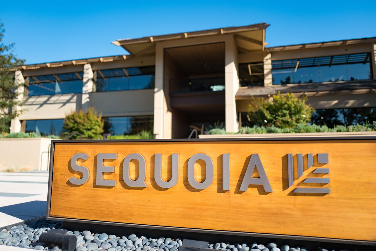 """A sign that reads """"Sequoia"""" sits in front of a chic building."""