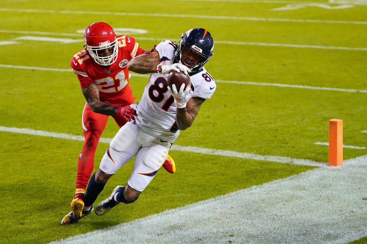 Denver Broncos wide receiver Tim Patrick (81) catches a touchdown pass while defended by Kansas City Chiefs cornerback Bashaud Breeland (21) during the second half at Arrowhead Stadium.