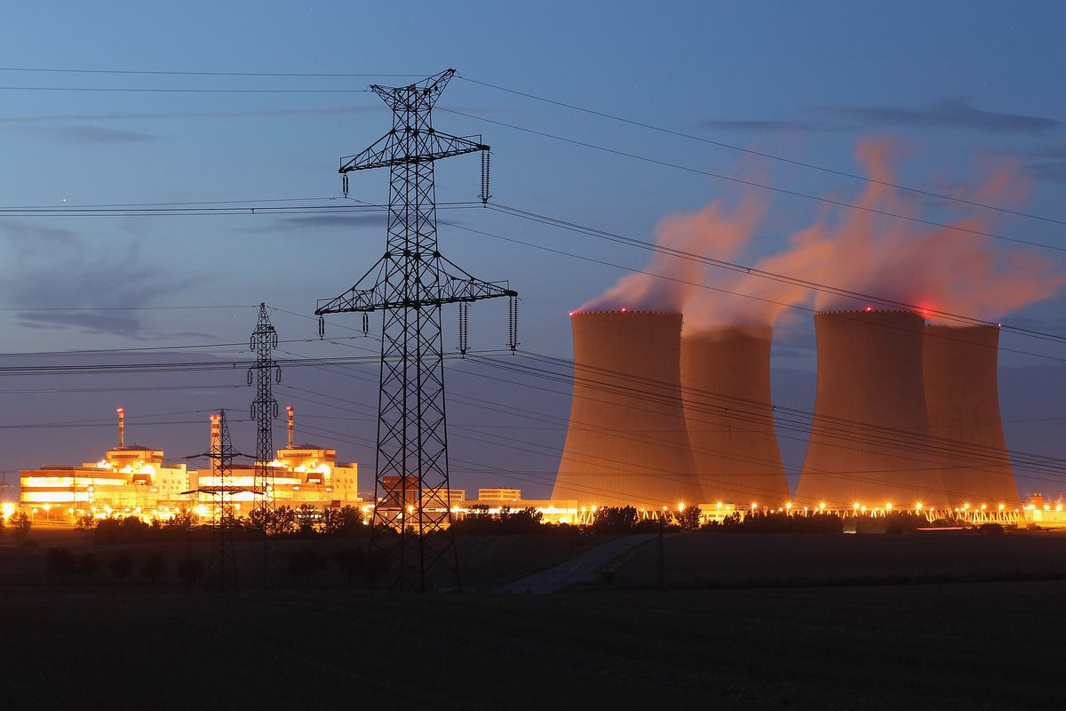 The four cooling towers and two reactor blocks of the Temelin nuclear power plant stand illuminated on August 11, 2011 near Temelin, Czech Republic.