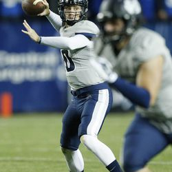 Utah State Aggies quarterback Darell Garretson (10) throws against Brigham Young Cougars in Provo Friday, Oct. 3, 2014.