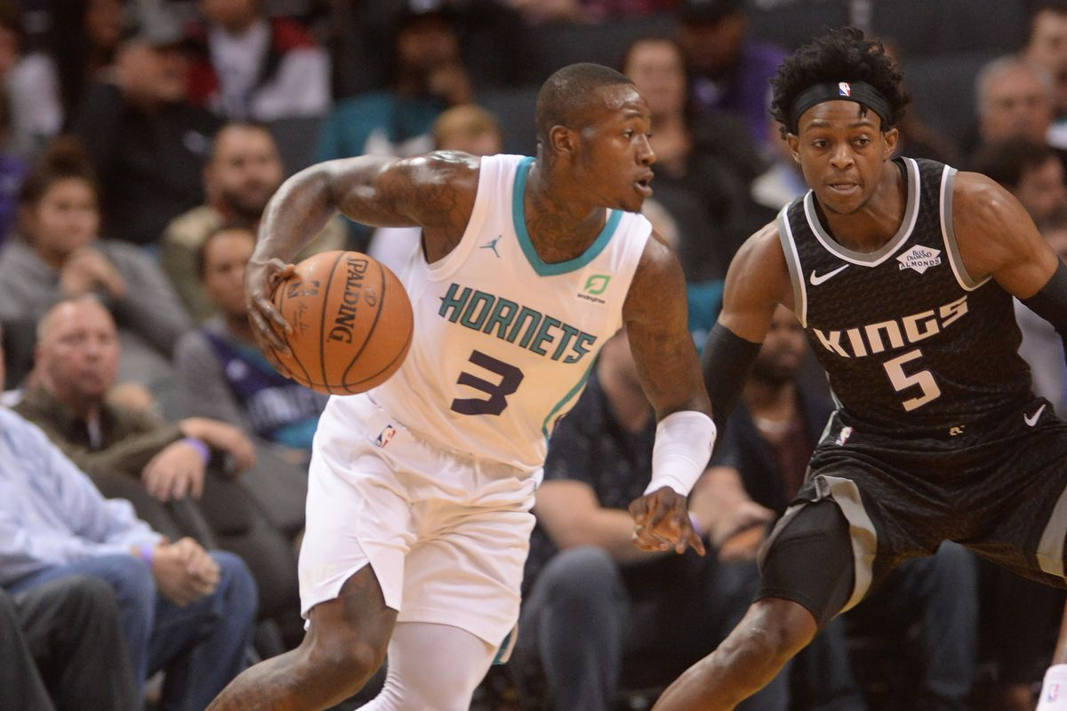 Charlotte Hornets guard Terry Rozier drives past Sacramento Kings guard De'Aaron Fox during the first half at the Spectrum Center.
