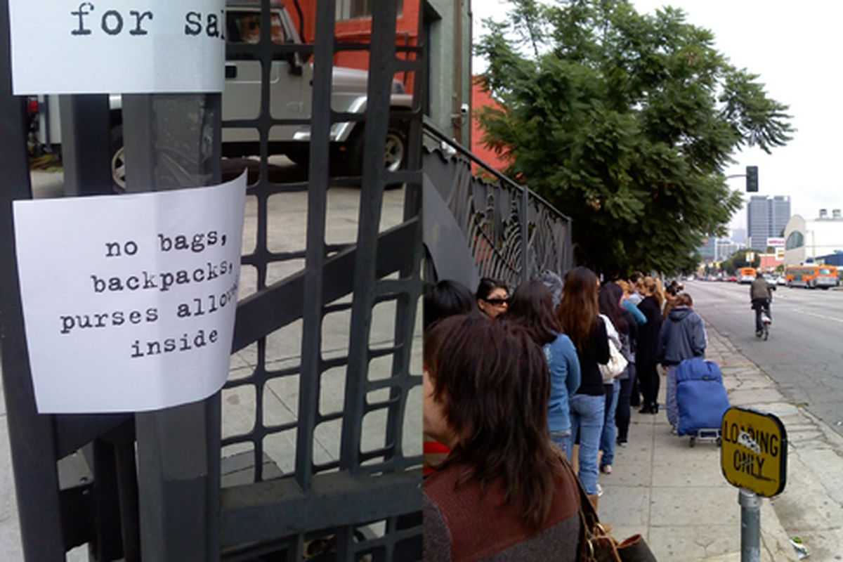 """Heed the """"no backpacks and purses"""" sign. Coupla ladies were told they couldn't get in unless they ditched the bags."""