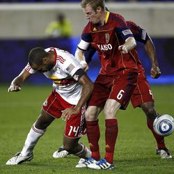 HARRISON, NJ - SEPTEMBER 21:  Thierry Henry  #14 of the New York Red Bulls fights for the ball with Nat Borchers #6 of the Real Salt Lake during their game at Red Bull Arena on September 21, 2011 in Harrison, New Jersey.  (Photo by Jeff Zelevansky/Getty Images)