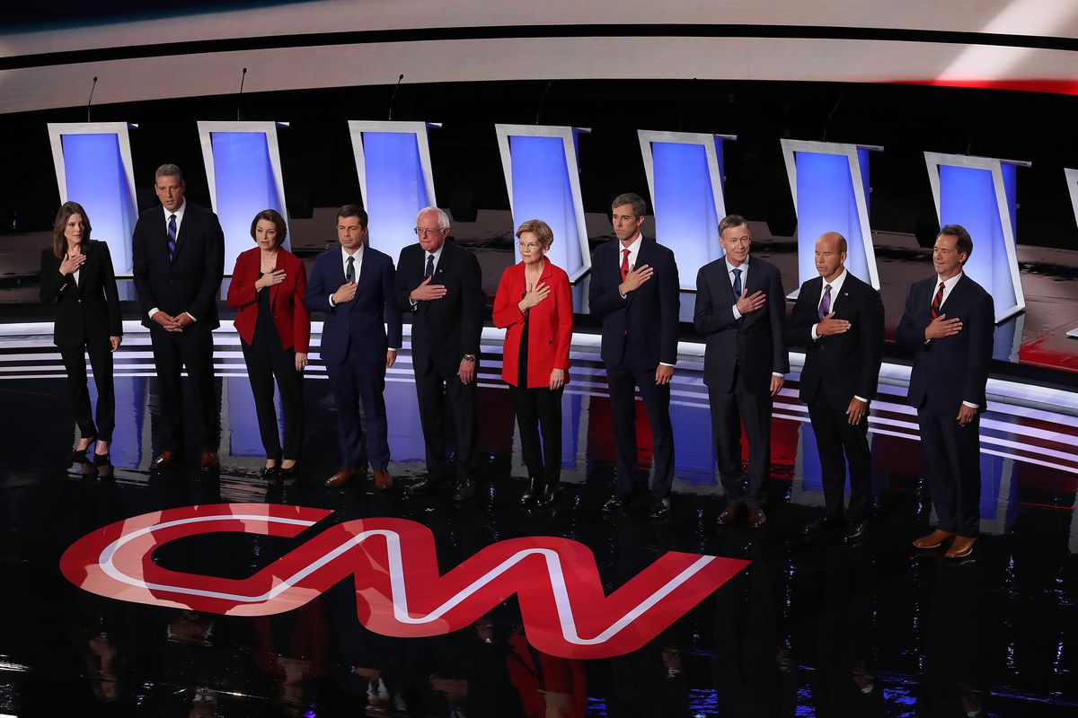 Democratic presidential candidates take the stage at the beginning of the Democratic Presidential Debate at the Fox Theatre in Detroit, Michigan on July 30, 2019.