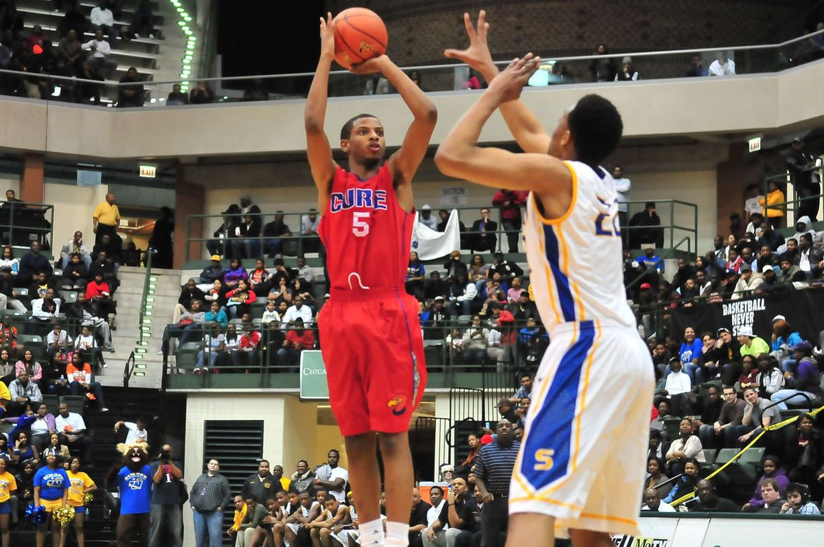 Curie's Devin Foster shoots a jumper over Jabari Parker of Simeon. Patrick Gleason/ For the Sun-Times.